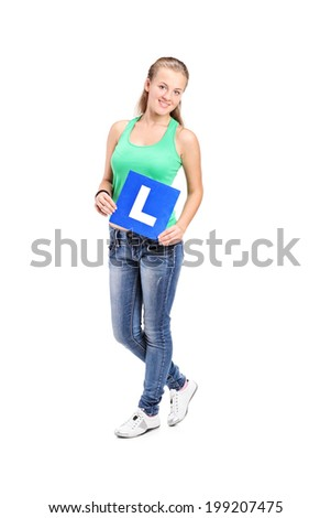Full length portrait of a young girl holding an l sign isolated on white background - stock photo