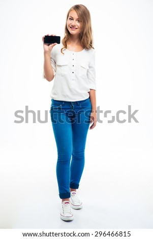 Full length portrait of a young girl showing smartphone screen isolated on a white background - stock photo
