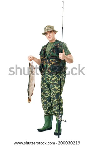 Full length portrait of a young happy fisherman with his catch showing thumbs up gesture isolated on white background - stock photo