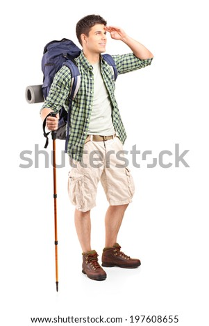 Full length portrait of a young hiker looking in the distance isolated on white background - stock photo