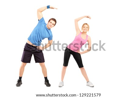 Full length portrait of a young male and female exercising, isolated on white background - stock photo