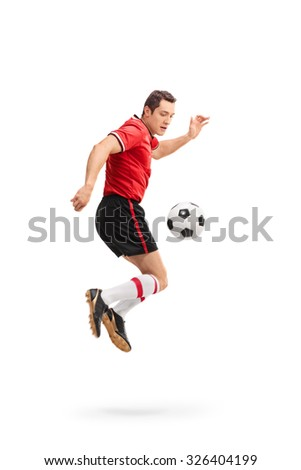 Full length portrait of a young male football player shot in mid-air while performing rainbow flick isolated on white background - stock photo