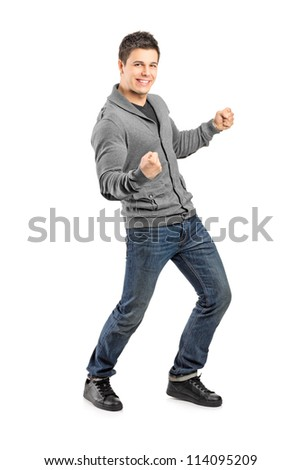 Full length portrait of a young male gesturing happiness isolated on white background - stock photo