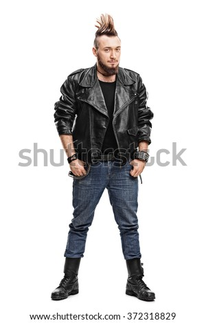 Full length portrait of a young male punk in a black leather jacket and black boots isolated on white background - stock photo