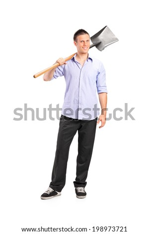 Full length portrait of a young man holding a shovel isolated on white background