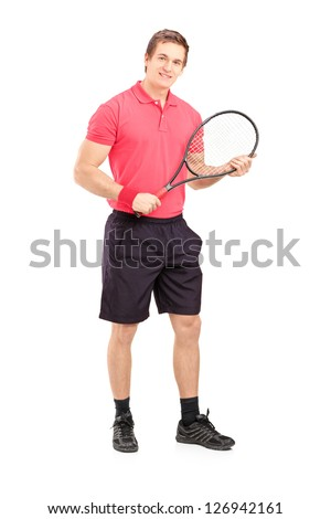 Full length portrait of a young man holding a tennis racket isolated on white background - stock photo