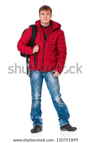 Full length portrait of a young man in winter clothing with backpack isolated on white background - stock photo