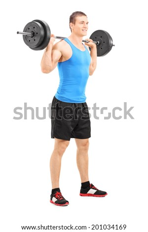 Full length portrait of a young man lifting a barbell isolated on white background