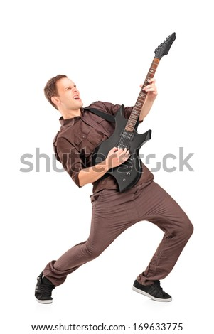 Full length portrait of a young man playing on electric guitar, isolated on white background
