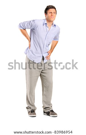 Full length portrait of a young man suffering from a back pain isolated on white background - stock photo