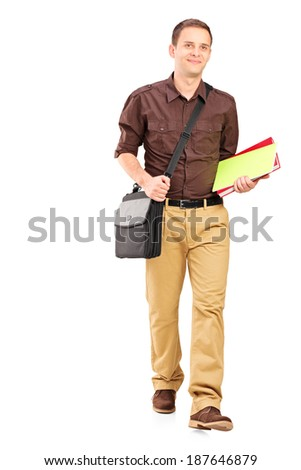 Full length portrait of a young man walking with books isolated on white background - stock photo