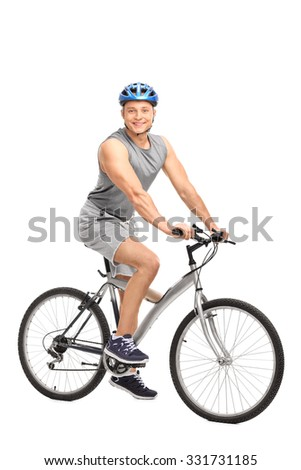 Full length portrait of a young man with a blue helmet sitting on his bicycle and looking at the camera isolated on white background