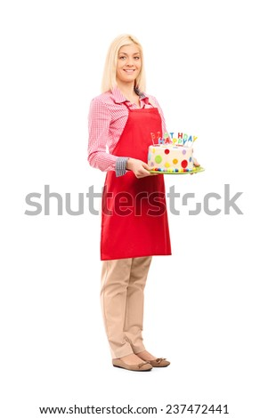 Full length portrait of a young mother holding birthday cake isolated on white background - stock photo