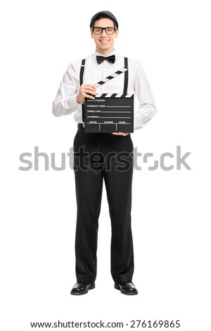 Full length portrait of a young movie director holding a movie clapperboard, smiling and looking at the camera isolated on white background - stock photo