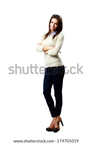 Full-length portrait of a young smiling businesswoman standing with arms crossed isolated on a white background - stock photo