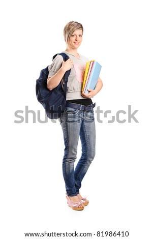 Full length portrait of a young smiling female holding a book isolated on white background - stock photo