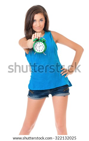 Full length portrait of a young smiling teen girl holding a alarm clock, isolated on white background  - stock photo