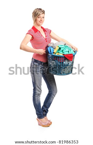 Full length portrait of a young woman holding a laundry basket isolated against white background - stock photo