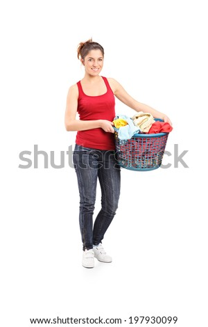 Full length portrait of a young woman holding a laundry basket isolated on white background