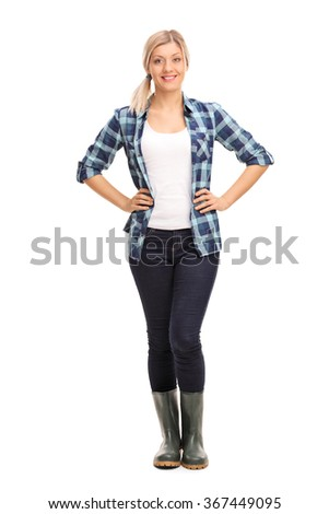 Full length portrait of a young woman in blue checkered shirt and green rubber boots isolated on white background - stock photo