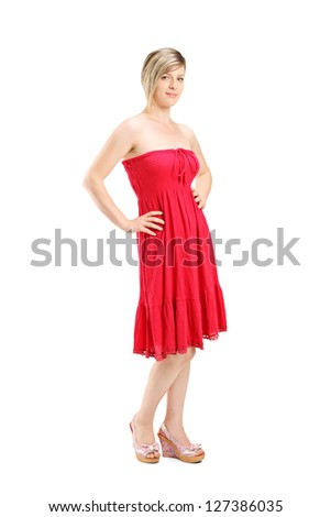 Full length portrait of a young woman posing in a red dress isolated on white background - stock photo