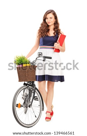 Full length portrait of a young woman with a bicycle, isolated on white background - stock photo