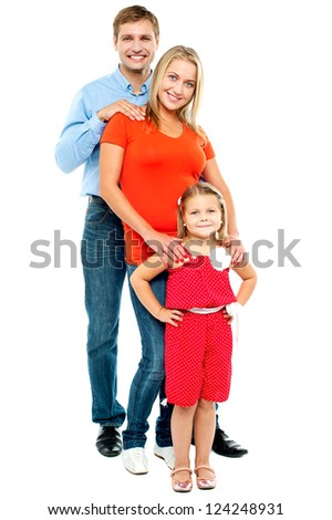 Full length portrait of adorable caucasian family of three standing behind one another - stock photo