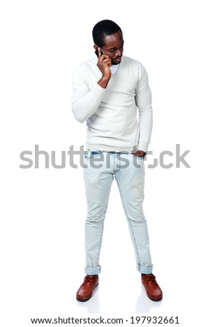 Full length portrait of african man talking on the phone isolated on a white background - stock photo