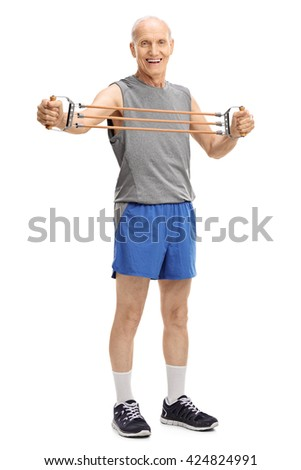 Full length portrait of an active senior exercising with a resistance band isolated on white background - stock photo