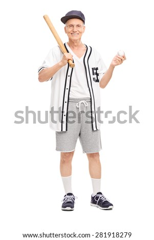 Full length portrait of an active senior in baseball jersey holding a baseball bat and a ball isolated on white background - stock photo