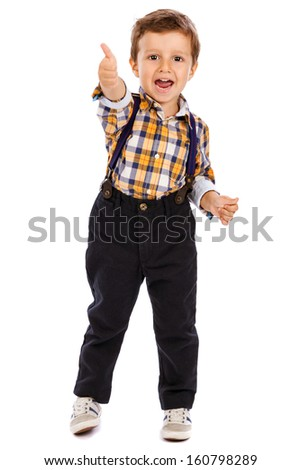 Full length portrait of an adorable little boy showing thumbs up isolated on white background - stock photo