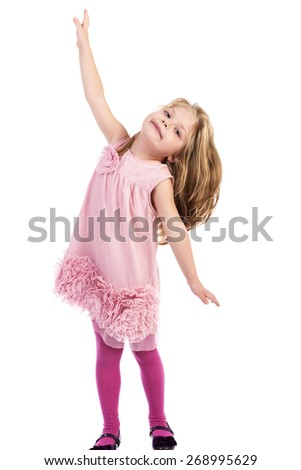 Full length portrait of an adorable little girl posing  over white background - stock photo