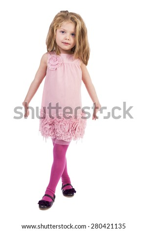 Full length portrait of an adorable little girl with pink dress  over white background - stock photo
