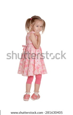 Full length portrait of an adorable little girl with pink dress standing over white background - stock photo