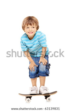 Full length portrait of an adorable young boy riding a skateboard isolated against white background - stock photo