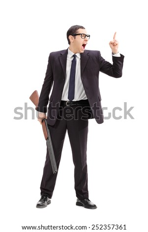 Full length portrait of an angry businessman holding a rifle and gesturing with finger isolated on white background - stock photo