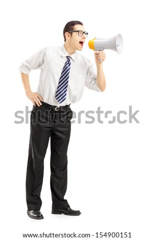 Full length portrait of an angry businessman shouting via megaphone isolated on white background