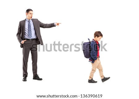 Full length portrait of an angry father shouting at his son, isolated on white background - stock photo