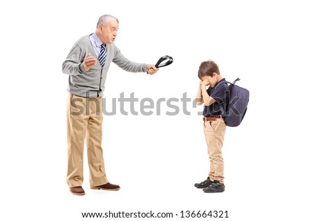 Full length portrait of an angry grandfather holding a belt and shouting at his nephew isolated on white background - stock photo