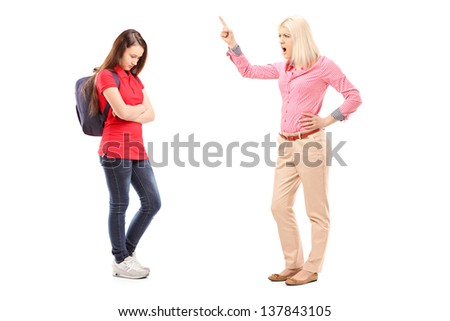 Full length portrait of an angry mother shouting at her daughter isolated on white background - stock photo
