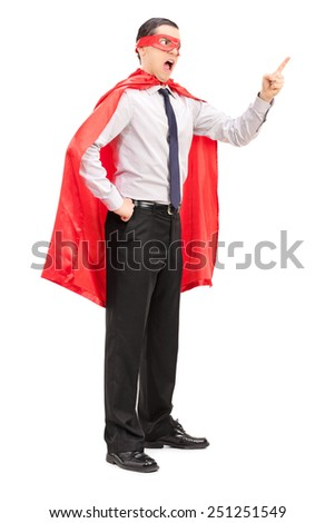Full length portrait of an angry superhero gesturing with his finger isolated on white background
