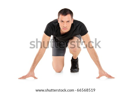Full length portrait of an athlete ready to run, looking towards isolated on white background - stock photo