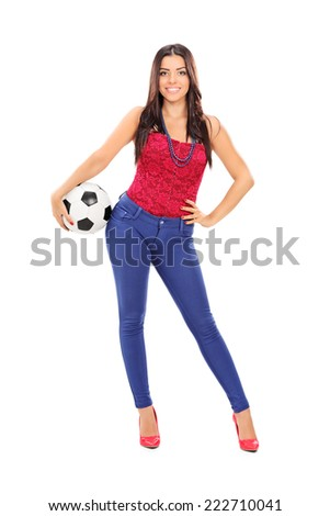 Full length portrait of an attractive girl holding a football isolated on white background - stock photo