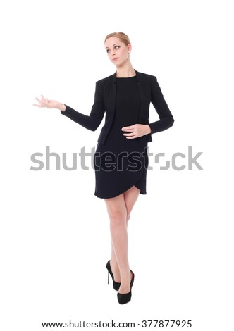 Full length portrait of an attractive professional woman wearing black dress suite and heels, isolated on a white background.