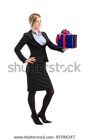 Full length portrait of an attractive woman holding a gift isolated on white background - stock photo