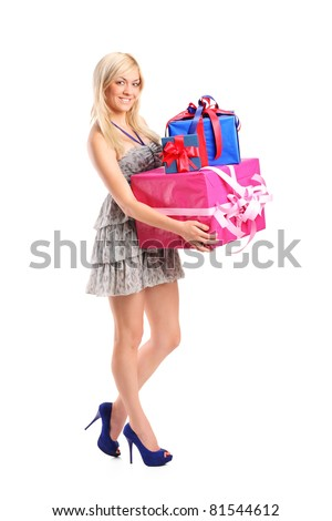 Full length portrait of an  attractive woman holding a gifts isolated on white background