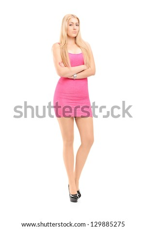Full length portrait of an attractive woman posing  in a pink dress - stock photo