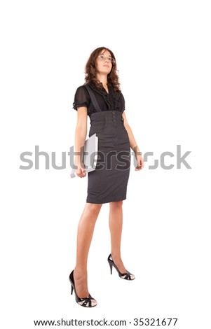 Full length portrait of an attractive young businesswoman, isolated on white background