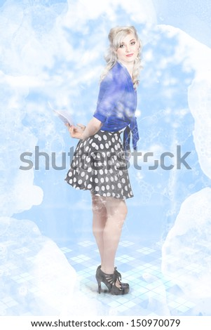 Full length portrait of an attractive young housewife doing a spring clean with spray and wipe dust remover. Housework concept - stock photo