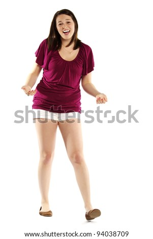 Full length portrait of an excited casual young girl on white background